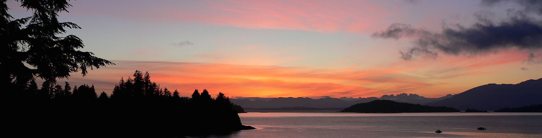 Beautiful Bamfield Sunset with pink sky over water